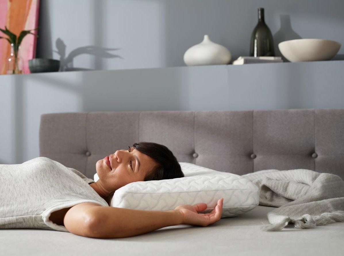 A person lying on a couch  Description automatically generated with medium confidence