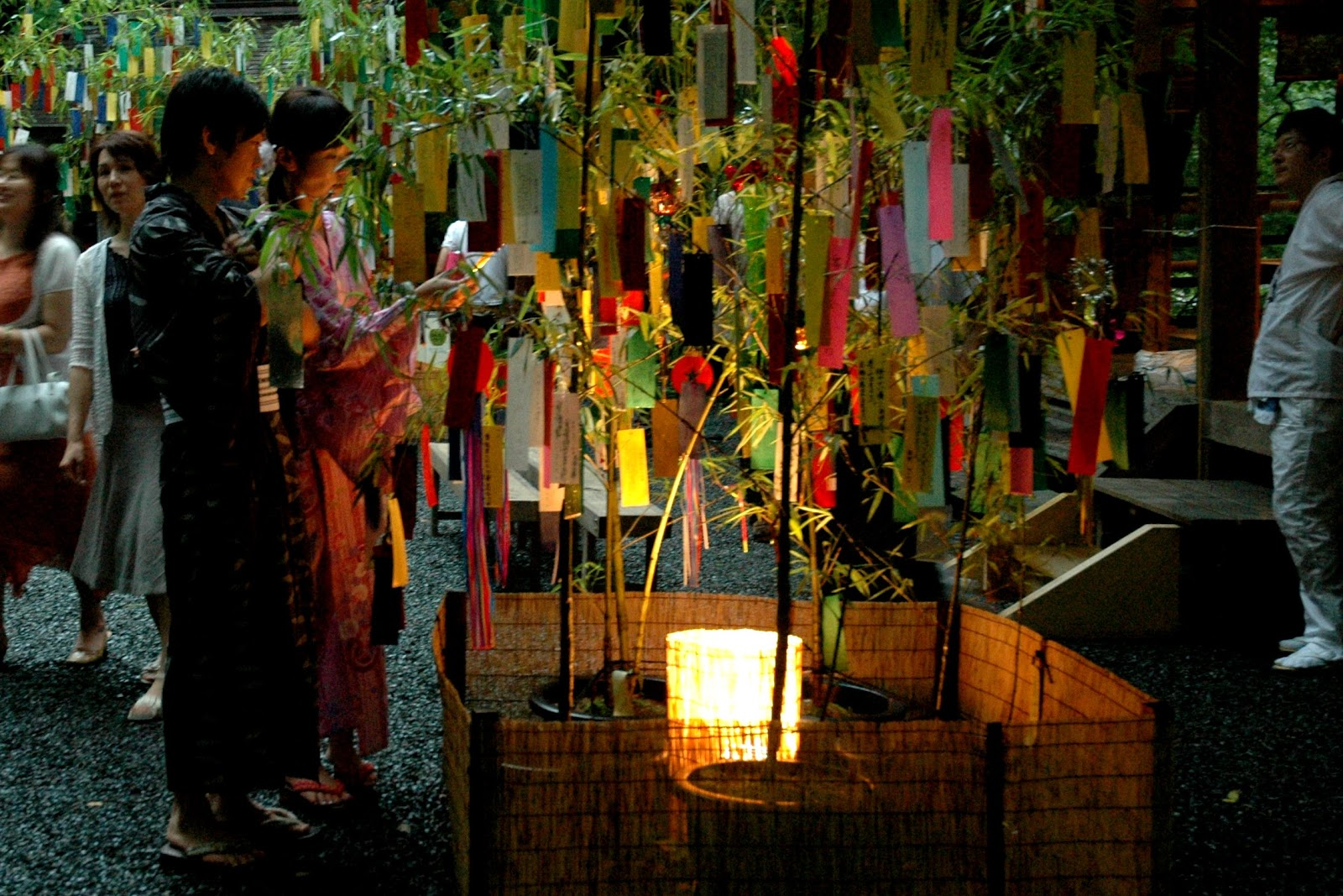 A couple hang tanzaku on bamboo at Tanabata in Japan (Credit: Yuki Yaginuma)