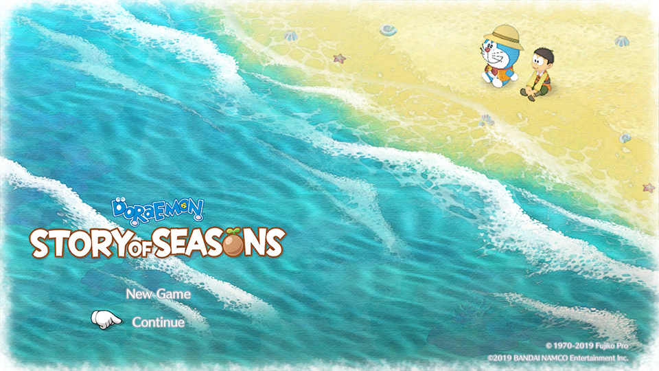 "A young boy (Noby) and a blue cat (Doraemon) sit next to each other on a beach, the title ""Doraemon Story of Seasons"" is on screen."