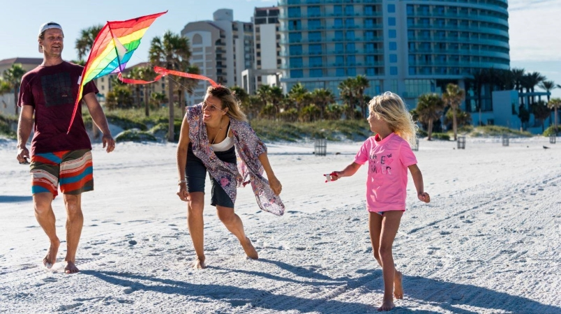 Family flying a kite on Clearwater Beach
