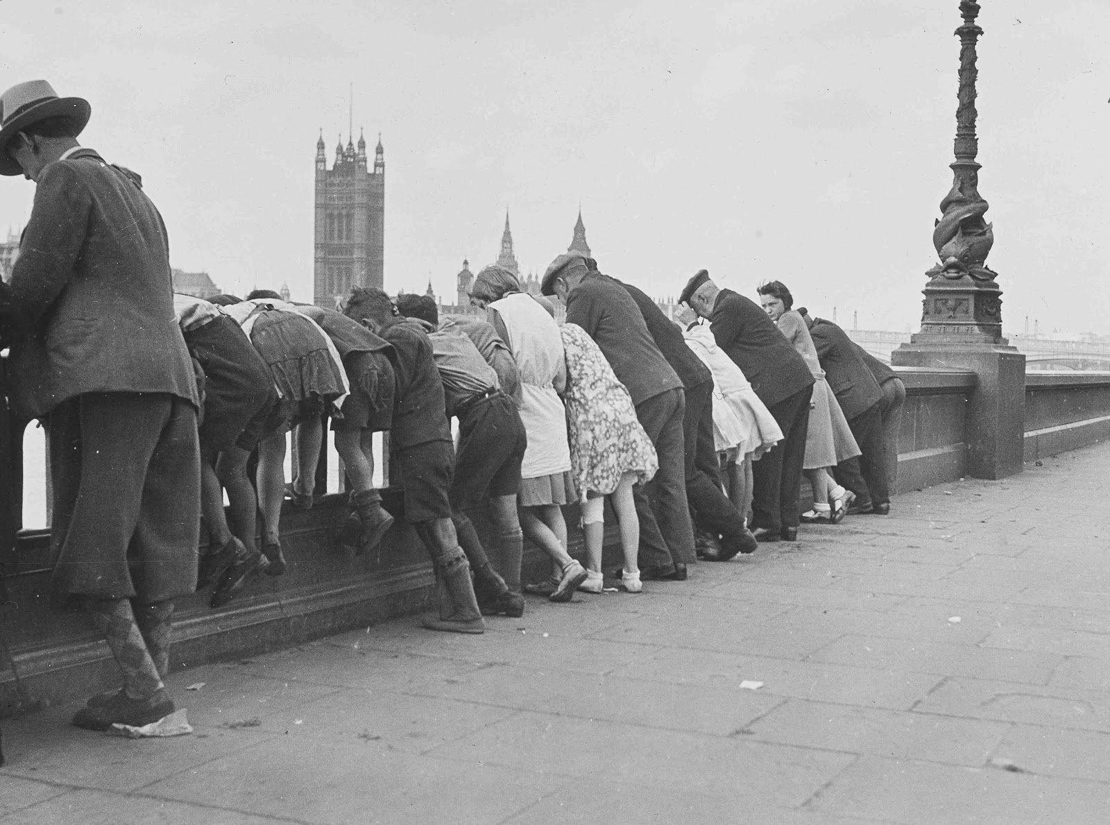 people looking at the Thames embankment