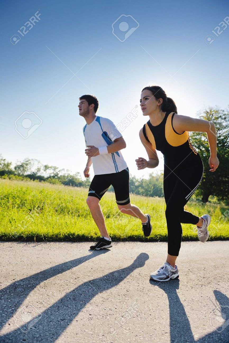 14680337-Young-couple-jogging-in-park-at-morning-Health-and-fitness--Stock-Photo.jpg