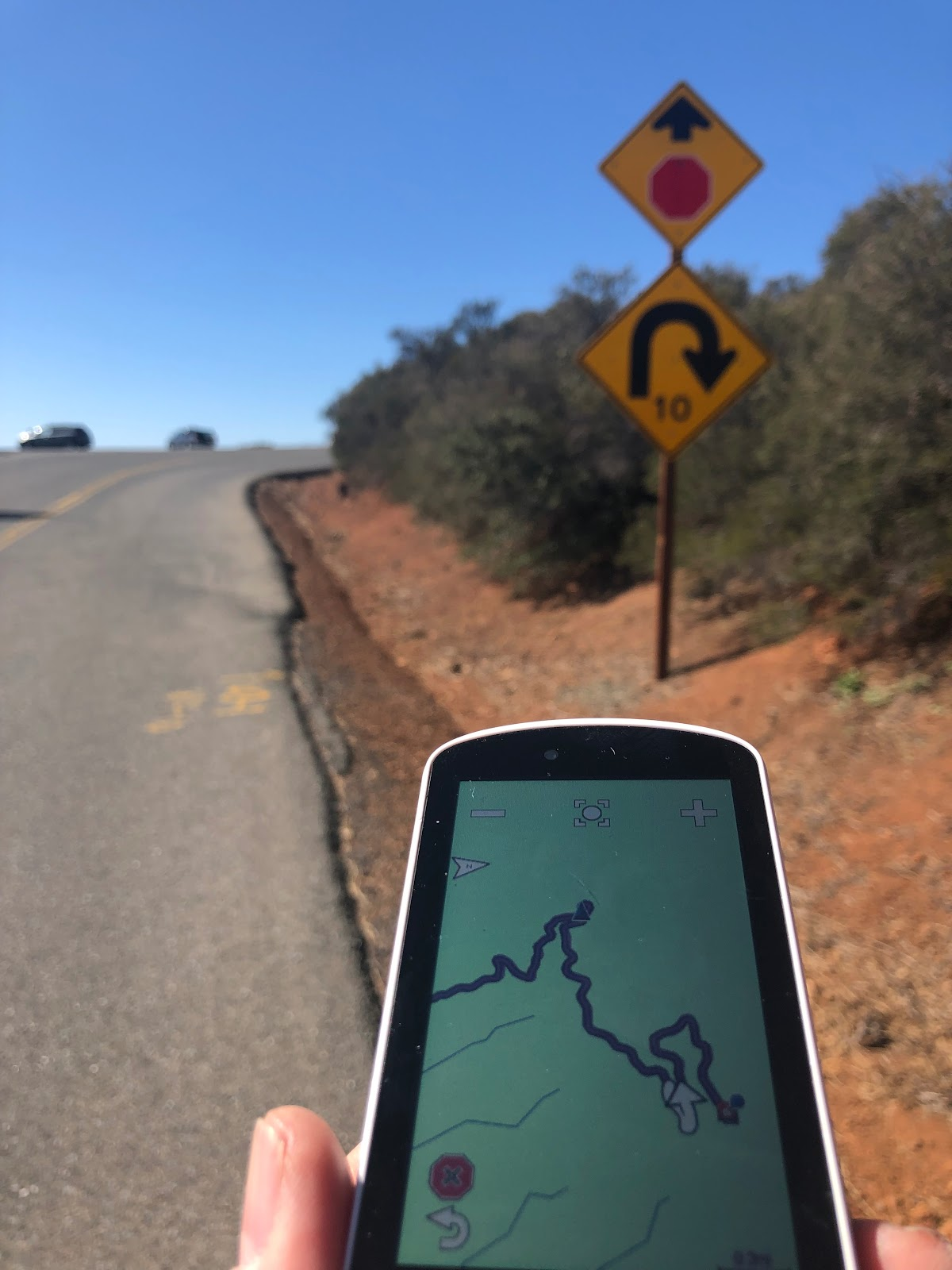 Cycling Mt. Diablo - Summit Road - road sign for curve - garmin map with hairpins