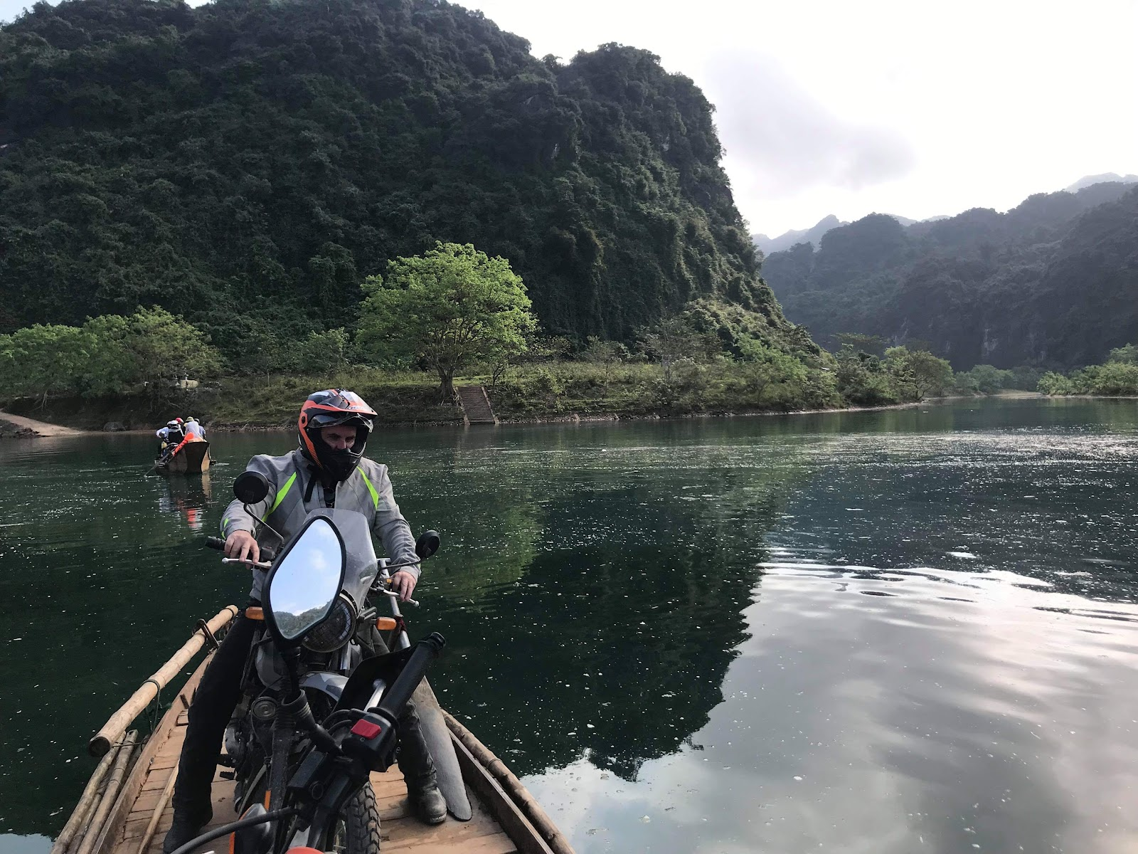 motorcycle on a boat going to Phong Nha