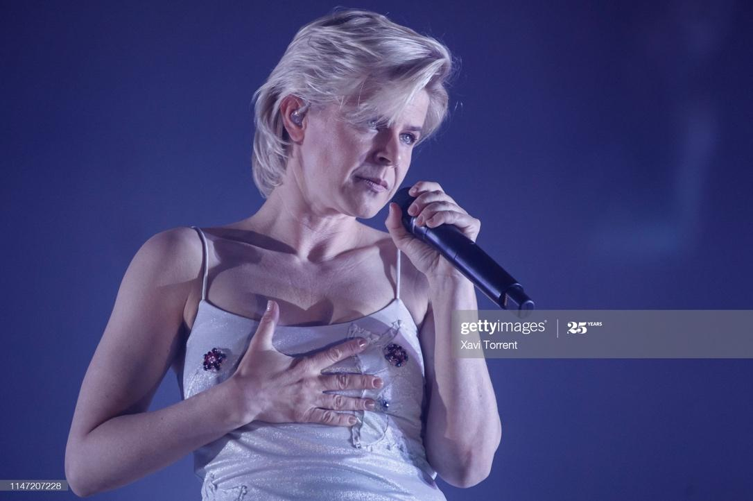 A picture containing singer Robyn, looking, front