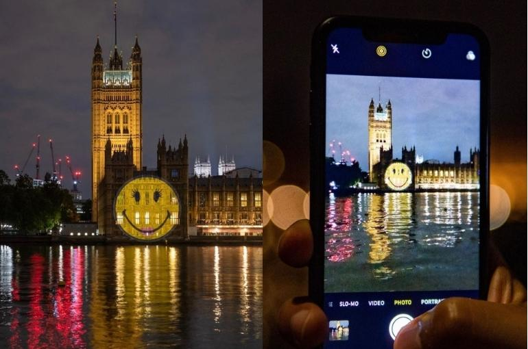 ecommerce trends: picture of smiley face projected onto the UK parliament