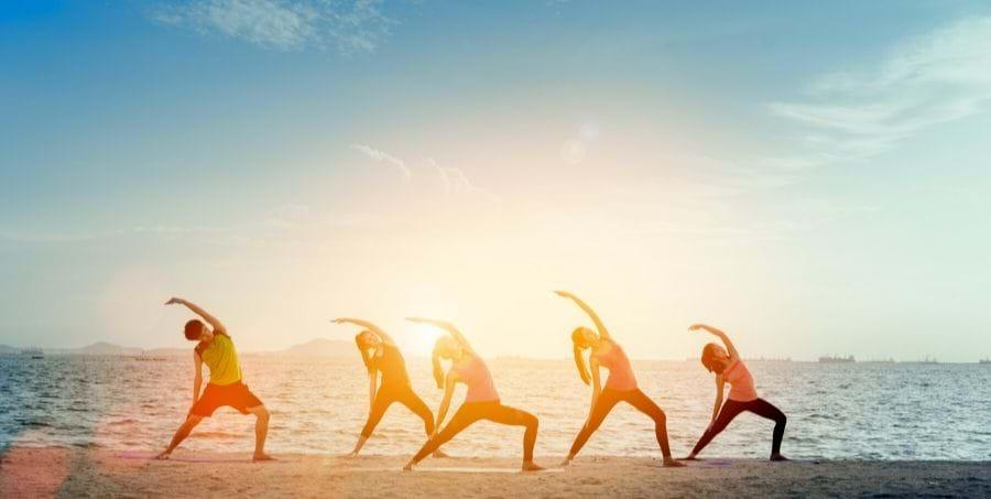 A group of people running on a beach  Description automatically generated with medium confidence