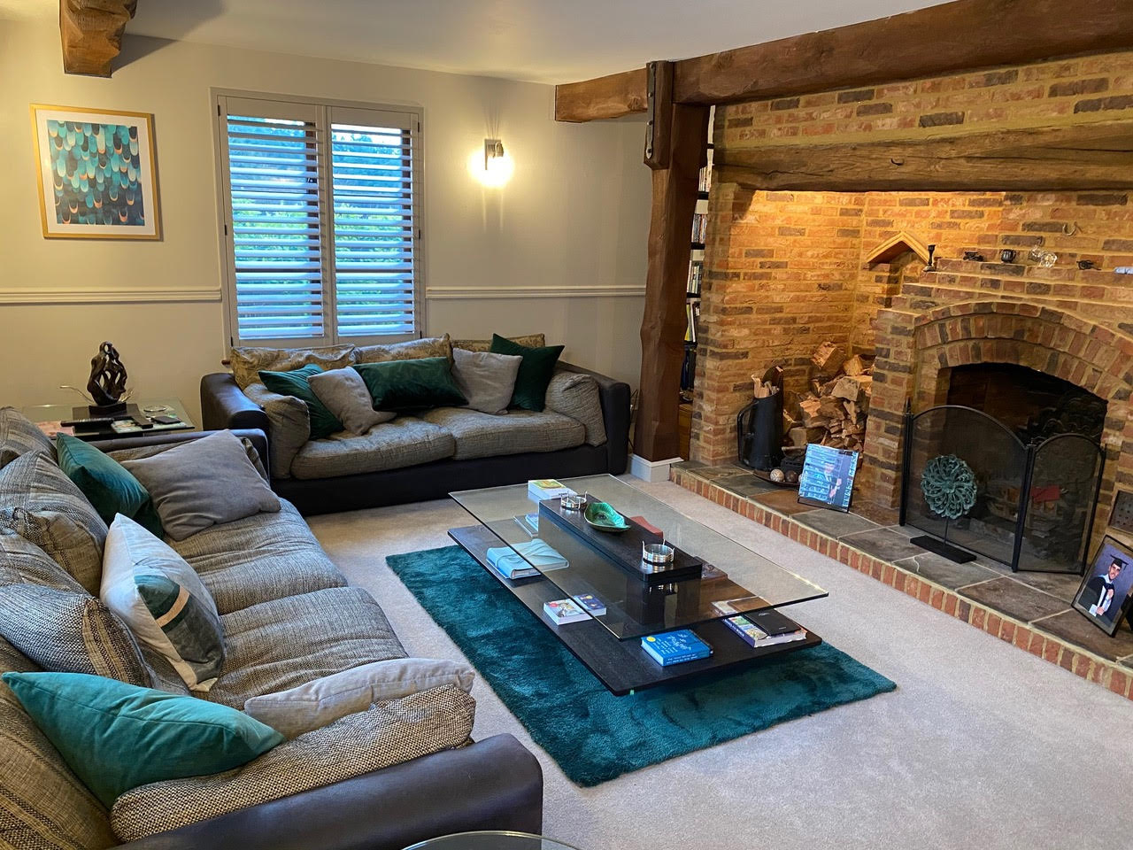 After room refresh by Juby Interior Design. Curtains and poles removed with bespoke shutters made and fitted. New accent colour to add some interest. New light fittings, rug, pictures and accessories to update the look of the room.