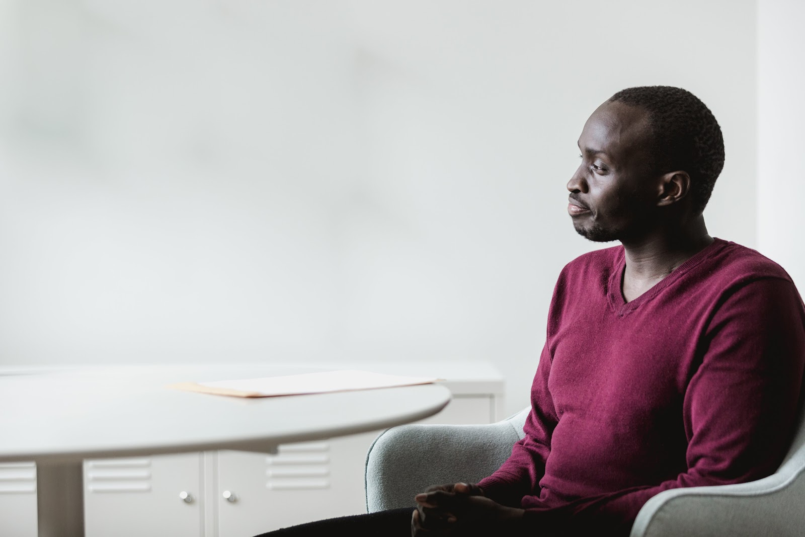 Man meditating and thinking in an office - meditation is a great way to overcome mental blocks | PulseBlueprint