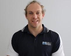 A portrait headshot of Travis Mattern of Fitness Education Online.