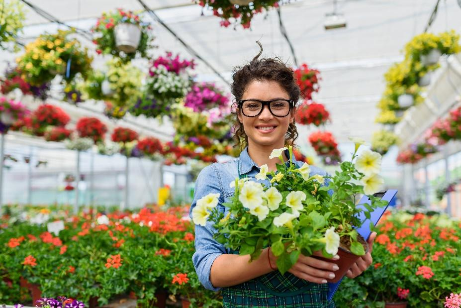 A person holding flowers  Description automatically generated with medium confidence