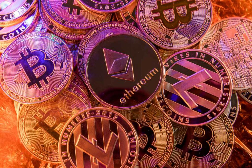 Many gold coins with cryptocurrency symbols such as Ethereum and Bitcoin