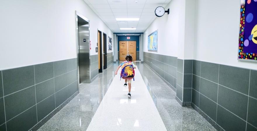 kid running down school hallway