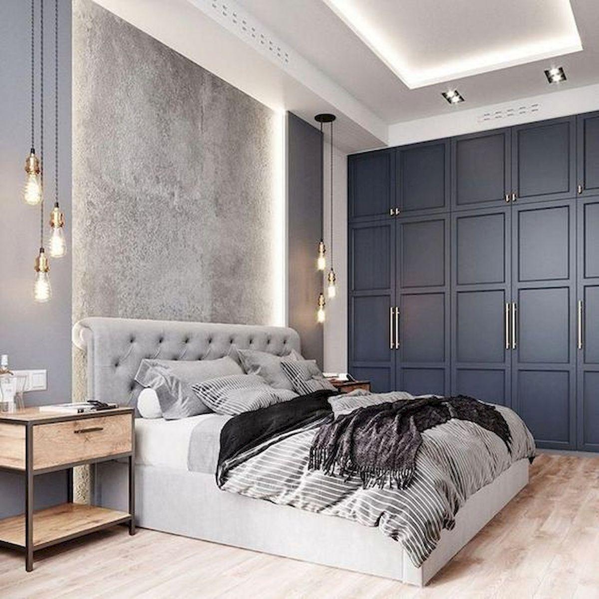 Phòng ngủ đẹp nhất với tủ âm tường xanh dương và đèn treo
