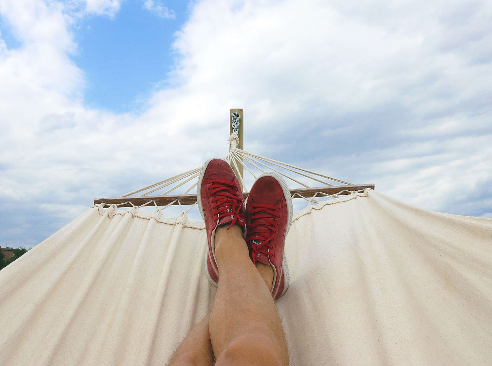 A person's feet in a hammock