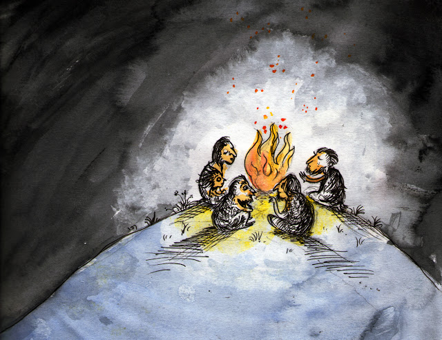 People around a bonfire in a cave