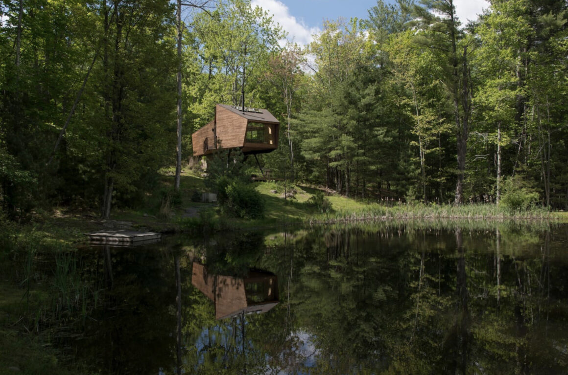 Scandinavian modern style suspended cabin overlooking lake