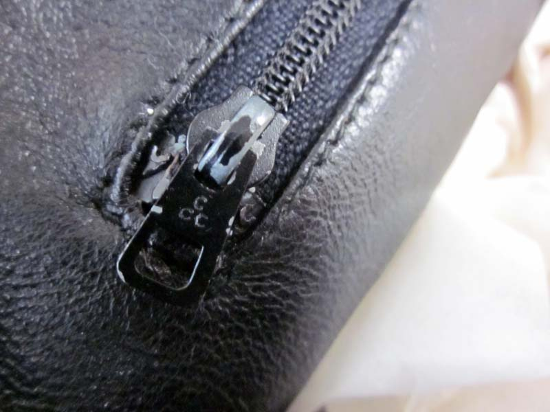 aaeabb439f Company 'DMC' zipper pull with a rounded double 'C' pull tag