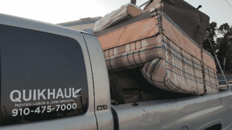 Old sofa in Quikhaul truck