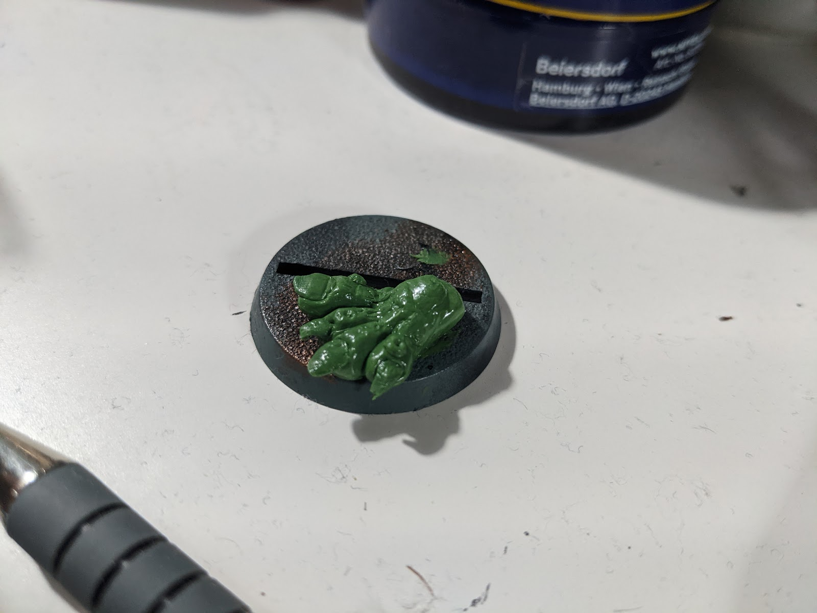 A troll's foot, sculpted out of green modelling putty.