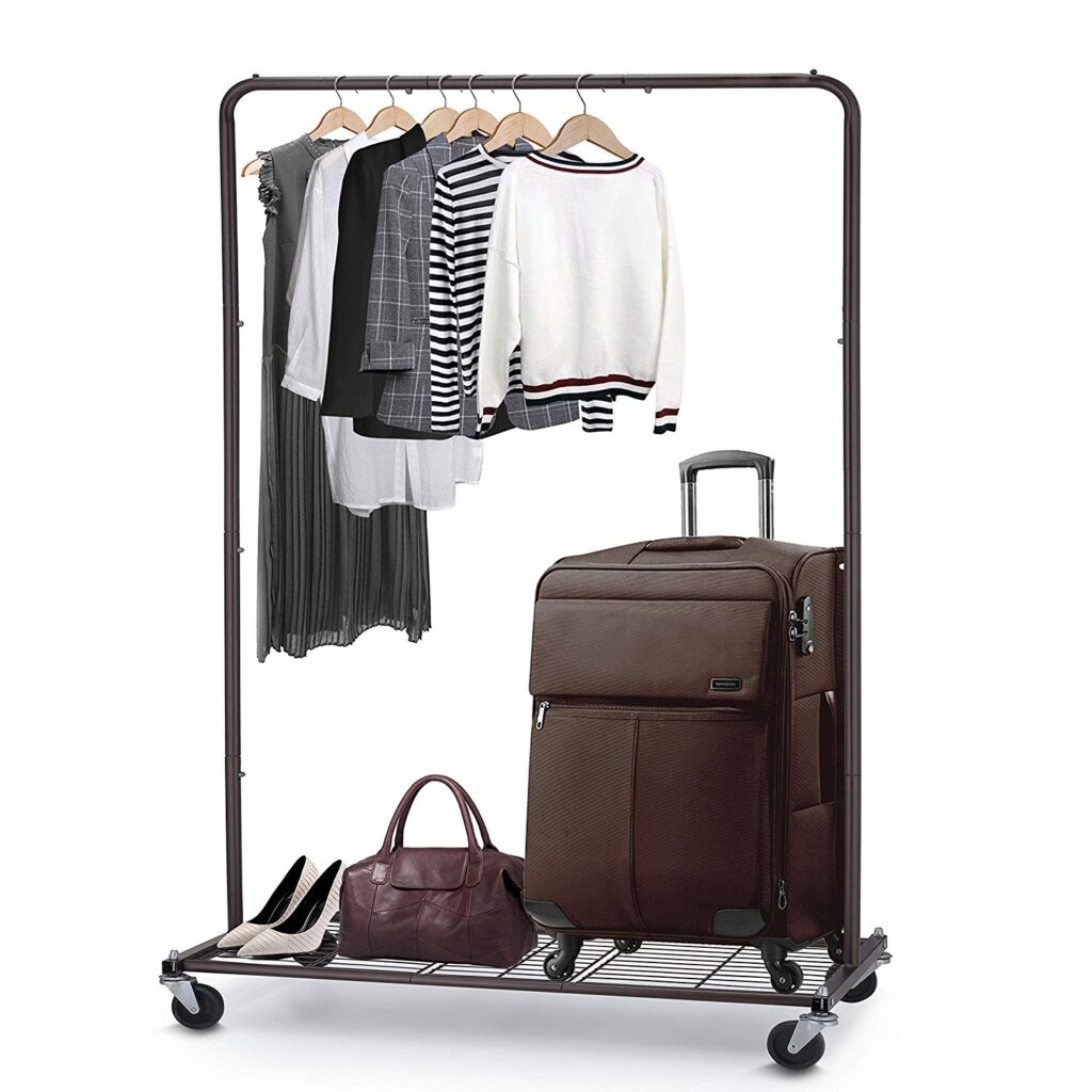 Room organization tips - metal clothing rack with shirts suitcase bag and shoes
