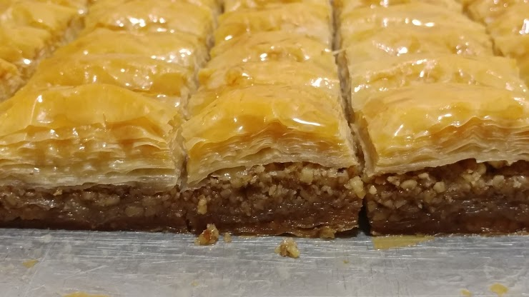 Baklava is made with rich amount of chopped Walnuts, light amount of sugar syrup (that has no honey) and Plant-based Butter. (Vegan)