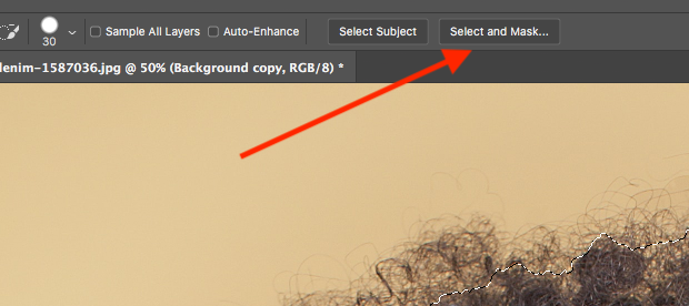 Select and Mask option indicated with a red arrow in Photoshop