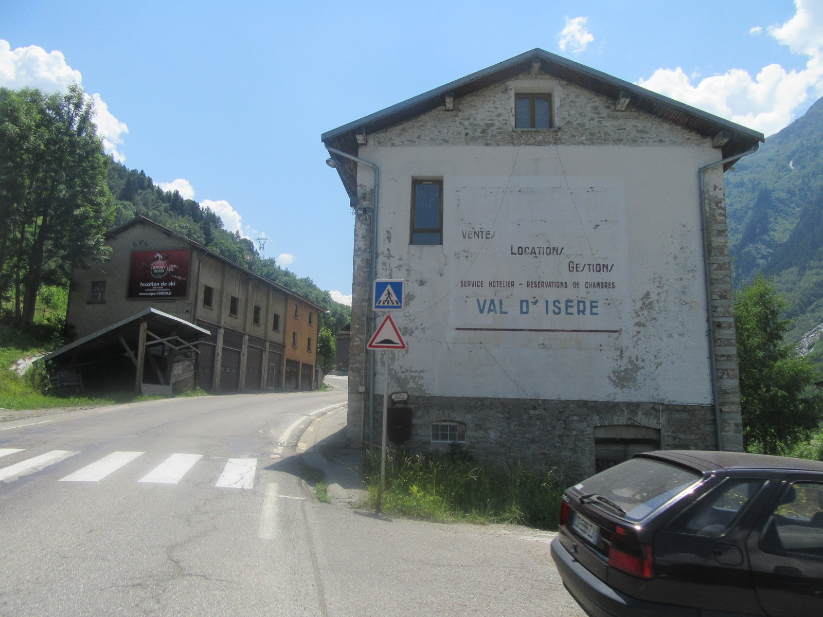 Bicycle ride of Col de L'Iseran from Val d'Isère - buildings in town and start of climb