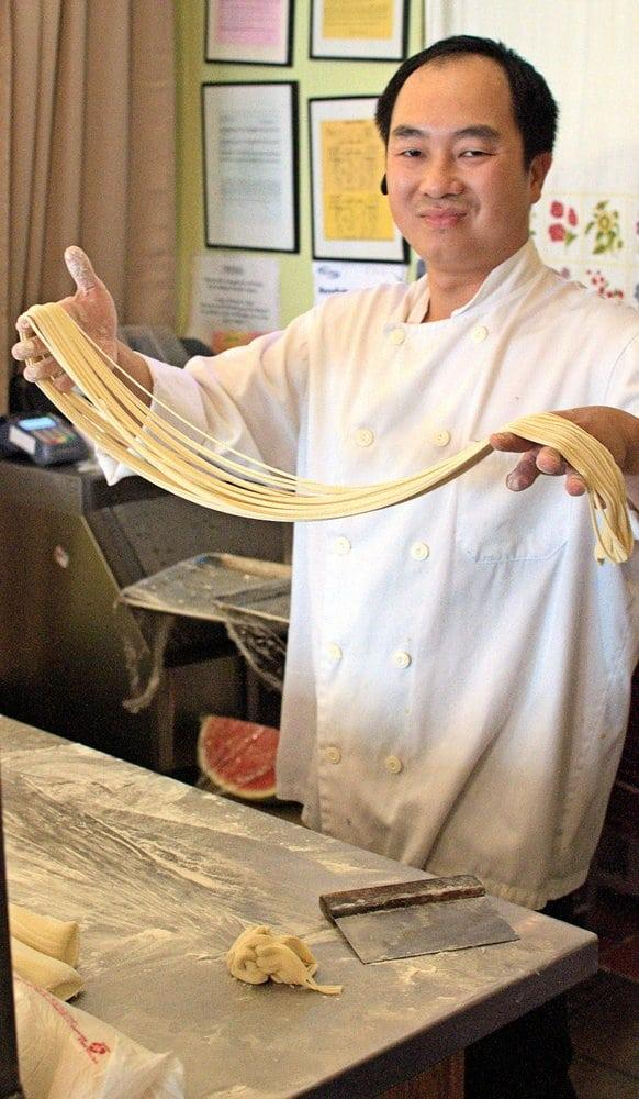 Photo of Ark Chinese Restaurant - Alameda, CA, United States. Chef making hand-pulled noodles