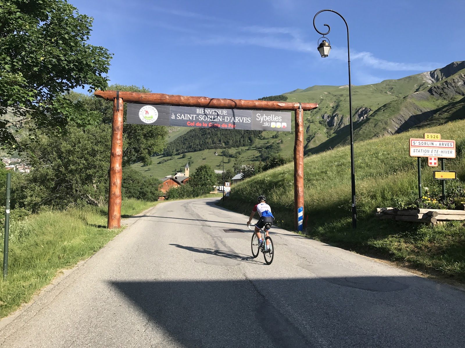 Bicycle ride Saint-Jean-de-Maurienne - cyclist on road going through entrance to Saint-Jean-d-Arves