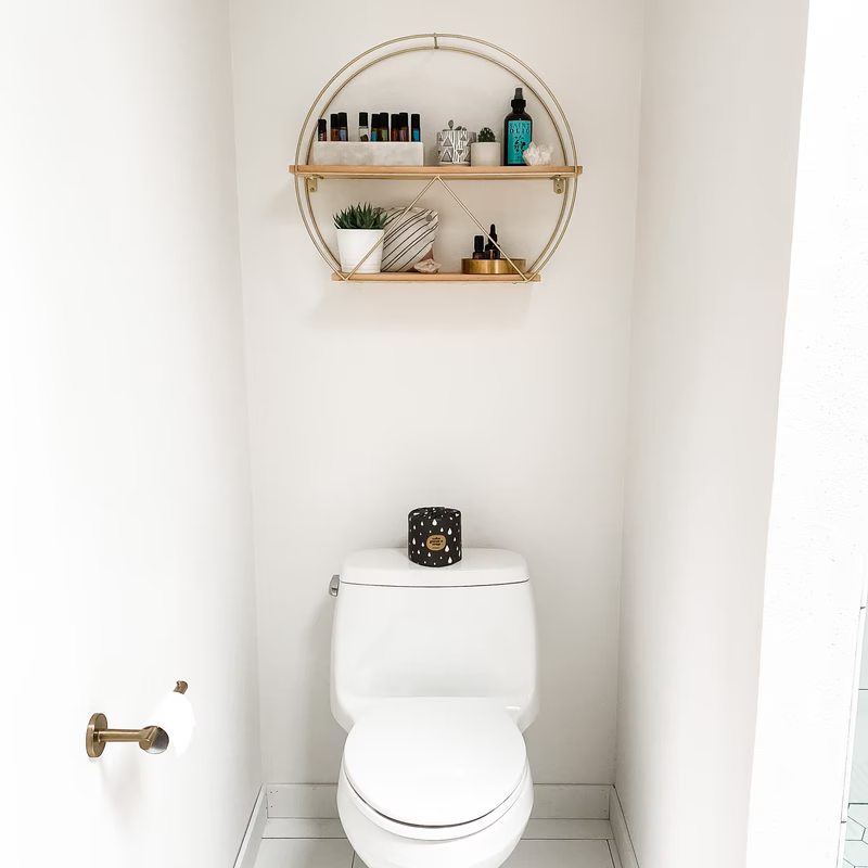Floating shelves above a toilet