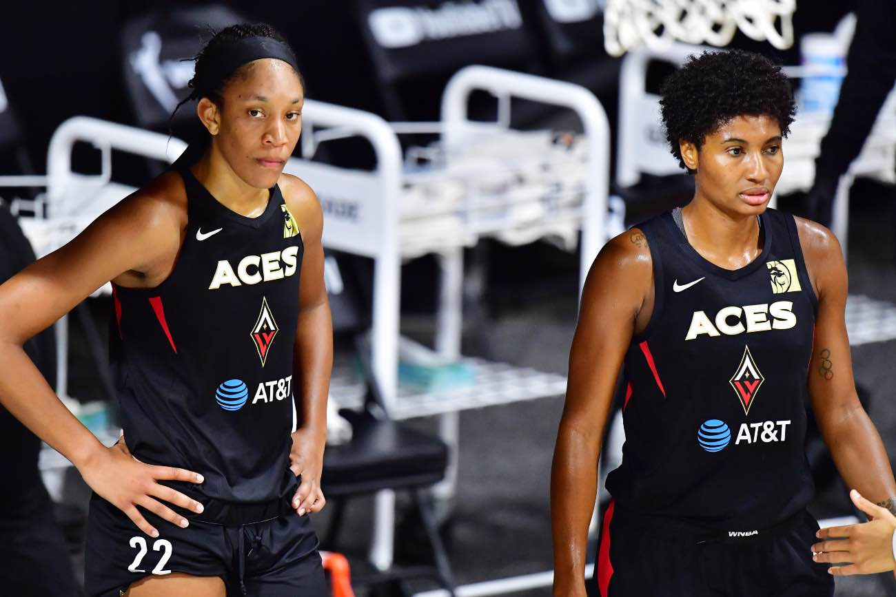 PALMETTO, FLORIDA - OCTOBER 04: A'ja Wilson #22 and Angel McCoughtry #35 of the Las Vegas Aces looks on during a timeout in the second half of Game 2 of the WNBA Finals against the Seattle Storm at Feld Entertainment Center on October 02, 2020 in Palmetto, Florida. (Photo by Julio Aguilar/Getty Images)