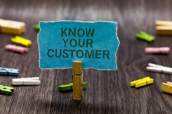 "Clothespin holding paper that says ""know your customer"""