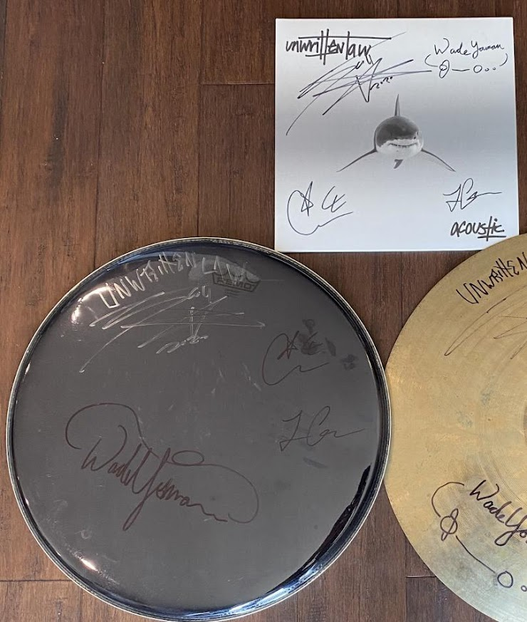 """A signed copy of our latest release """"Acoustic"""" on vinyl, and a signed drumhead"""