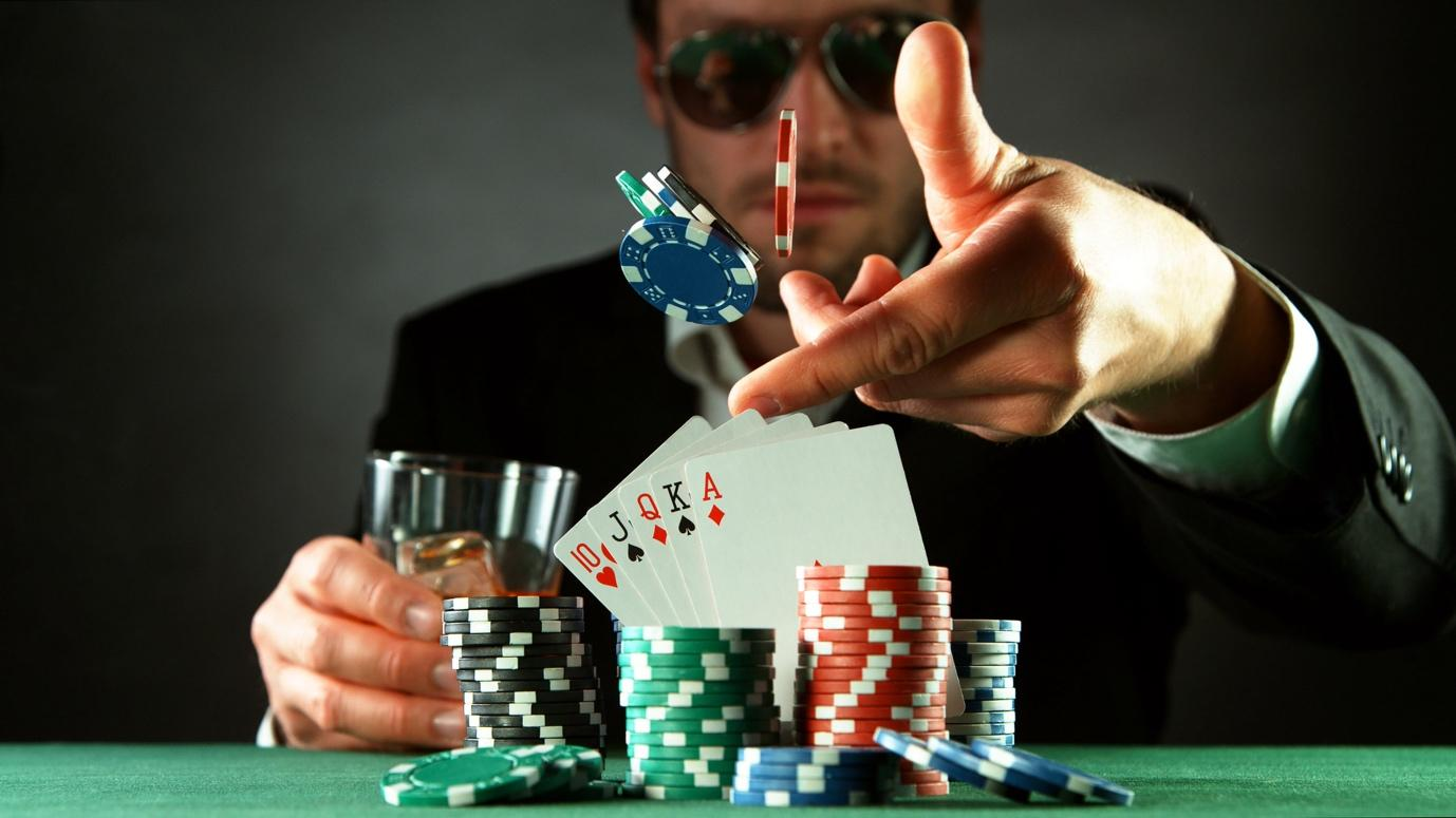 A picture containing person, gambling house, room, scene  Description automatically generated
