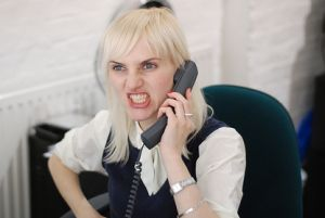 woman sneering while on phone