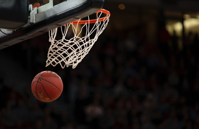 Basketball going out of the net representing sport movies
