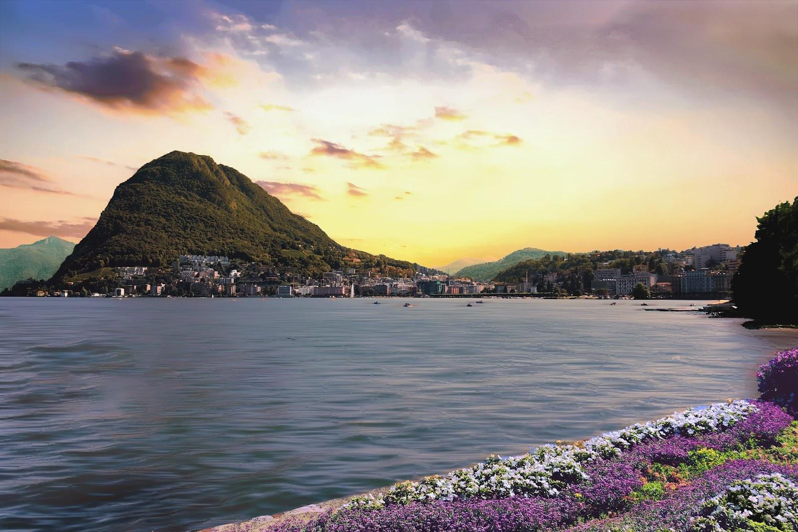 lake lugano large mountain flowers calm lake colorful sunset switzerland
