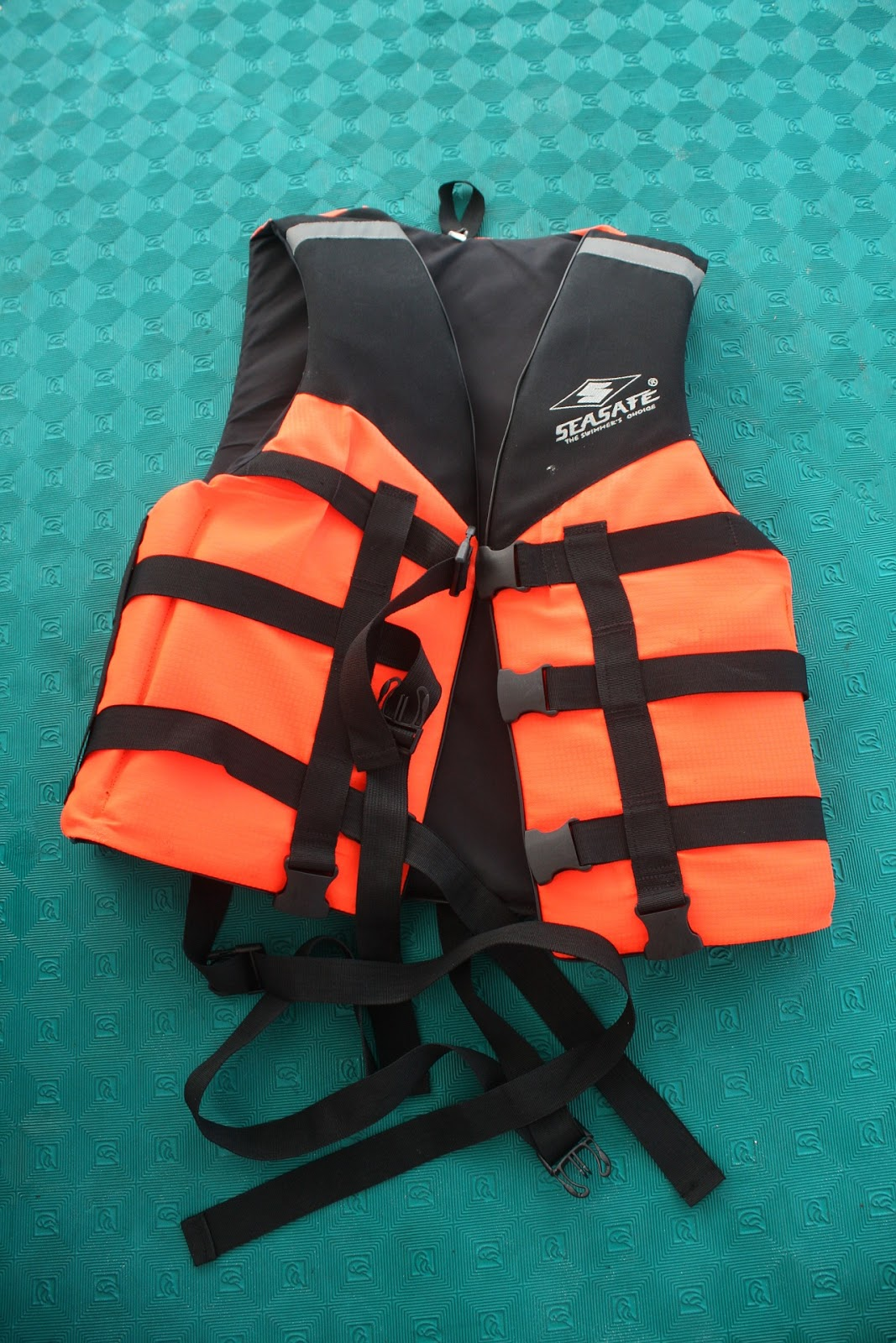 A photo of an orange and black life vest is shown.