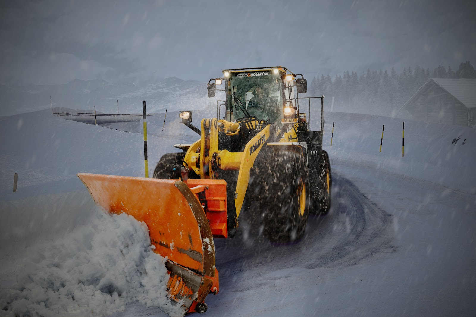 Snow plow preparing a business for winter weather to ensure the safety of employees.