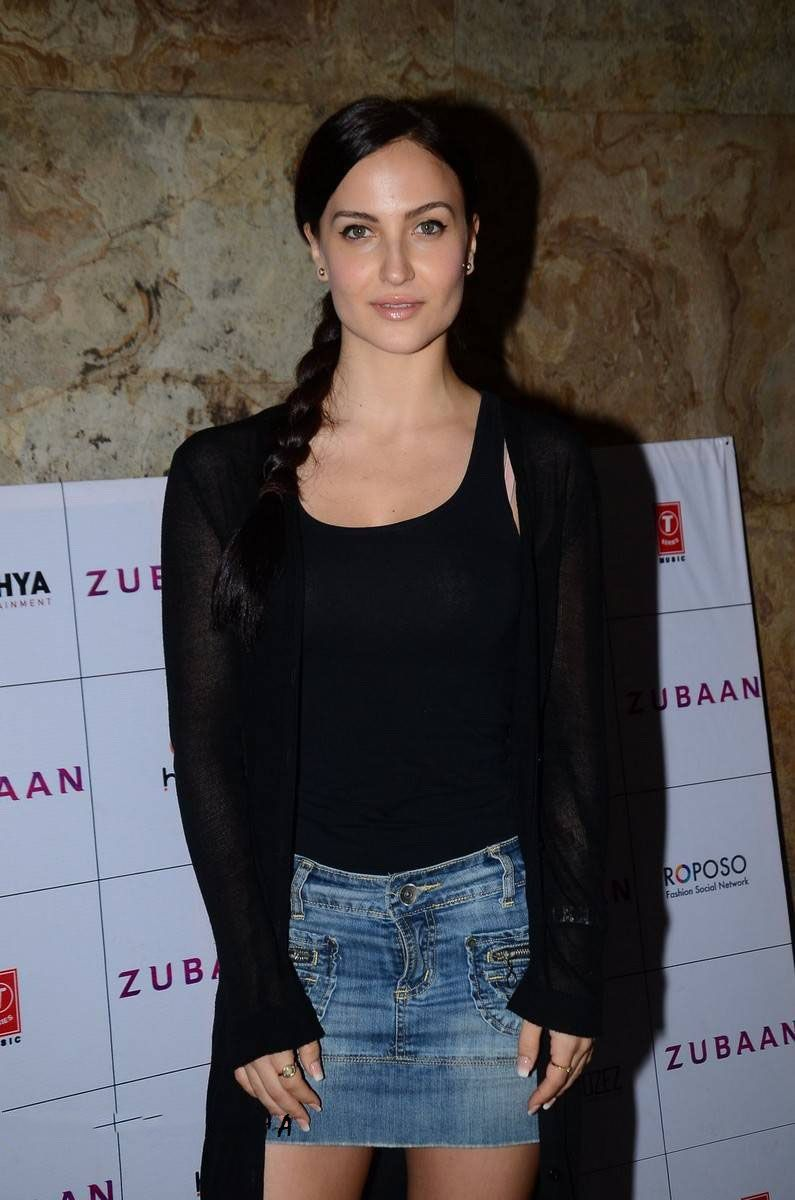 Elli Avram in short denim skirt and Black top.