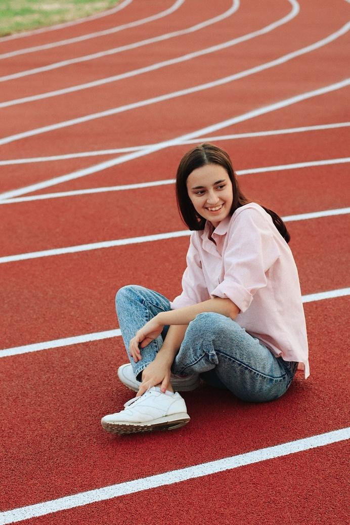 woman sitting on track - runners