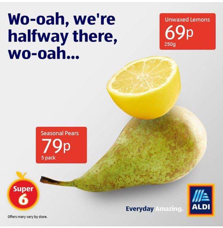 Aldi's grocery ad for lemons and pears. Text above reads: Wo-oah, we're halfway there, wo-oah…
