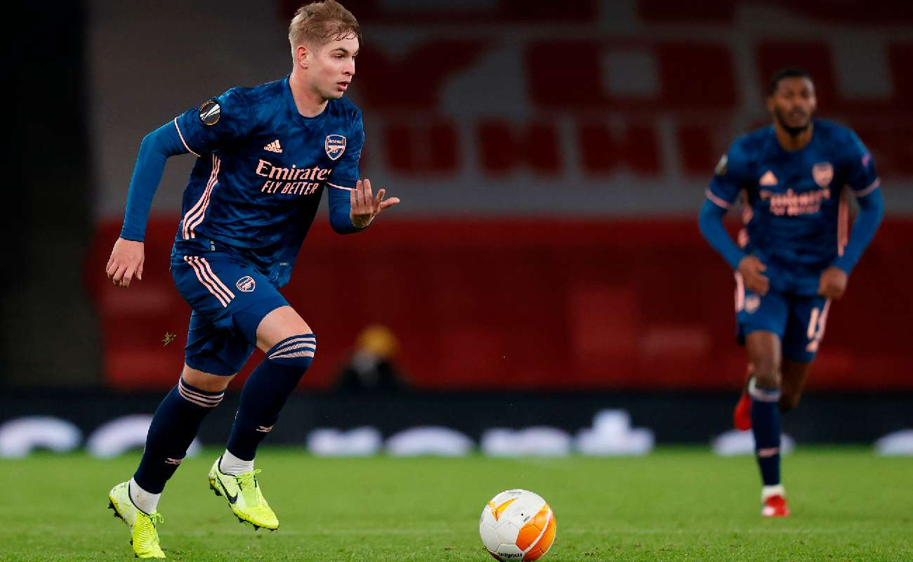 Arsenal youngster Emile Smith Rowe running onto the ball - Photo by ADRIAN DENNIS/AFP via Getty Images