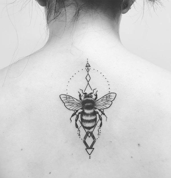 geometric bee tattoo on back