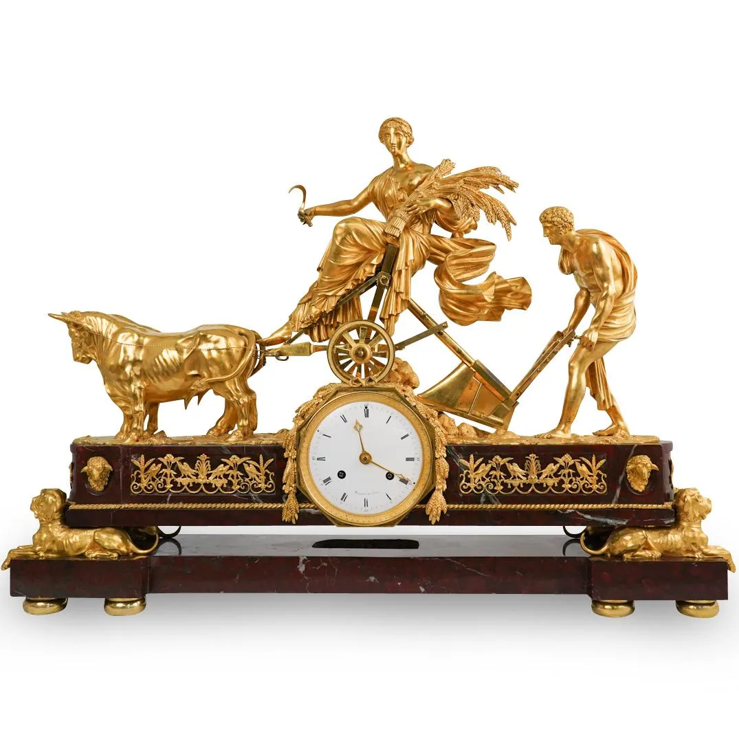 Rare 19th-century gilt bronze and red griotte marble mantle clock