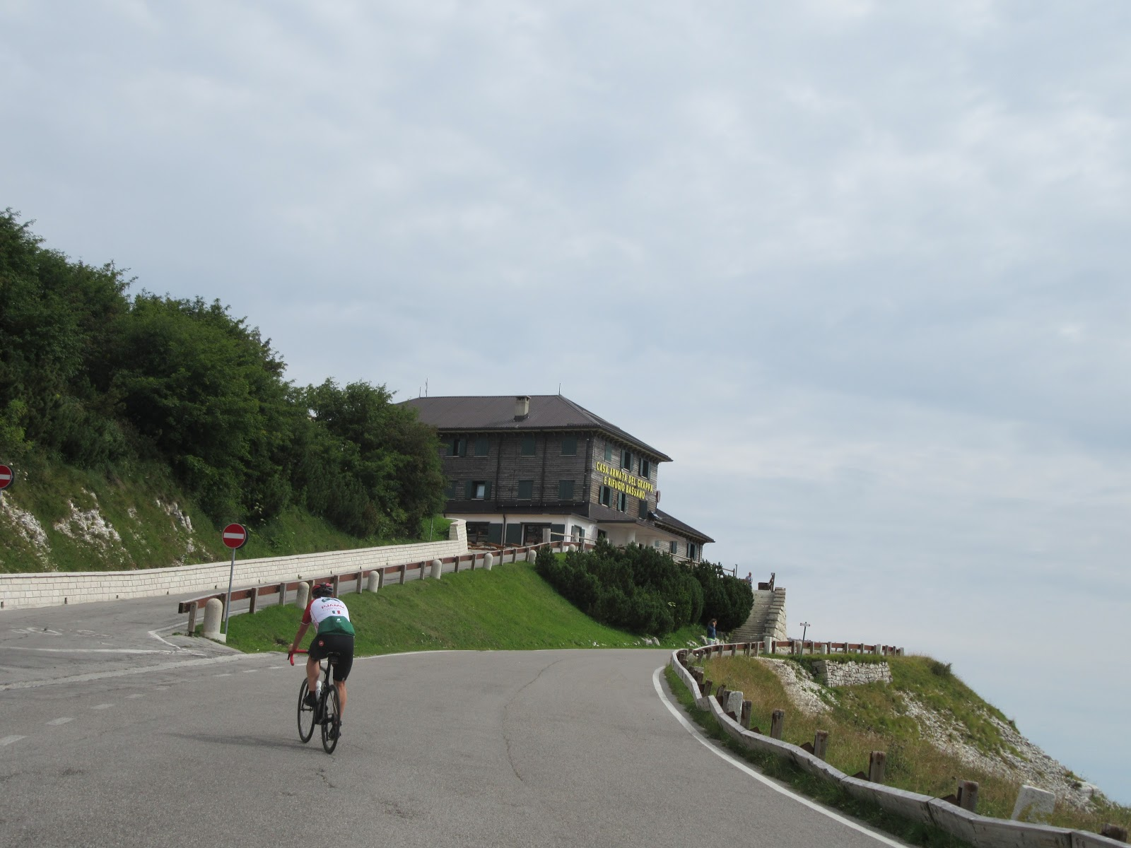 Cycling Monte Grappa from Fietta - cyclist riding on road to Rifugio Bassano a cima Grappa