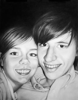 A boy and a girl posing for a photo  Description automatically generated