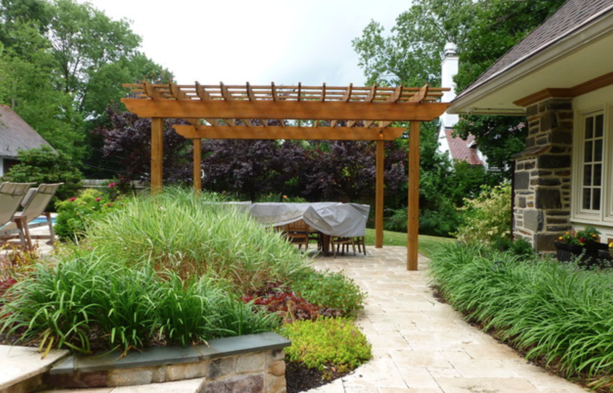 Pergola surrounded by bright plant life in Philadelphia