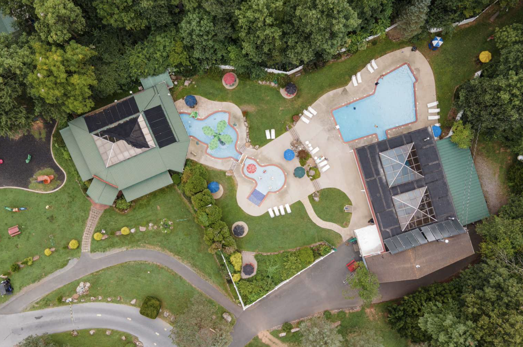 Aerial view of campground pool and welcome center at Lake in Wood RV Resort